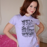 Angelic girl next door Anna strips out of her shirt and cute matching purple panties