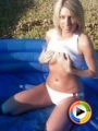 Watch as girl next door Becky plays with her baby oil covered tits outdoors