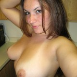 A very horny Kayla is topless in the kitchen