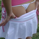 Amy flashes her ass and tiny thong out in a public park