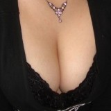 Kitty loves to tease the boys with her extremely lowcut shirt showing off her boobs