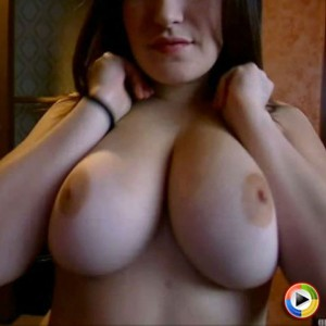 Kayla squeezes together and plays around with her huge boobs