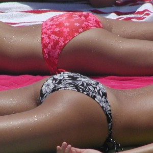 Hot tanned girls ass in tight bikinis at the beach