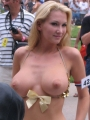 Big breasted blonde lets random people take pictures of her huge tits