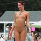 Hot strippers compete for awards at a outdoor public nudity festival