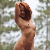 Lots of cute strippers show off their skills completely naked at an outdoor public nudity festival
