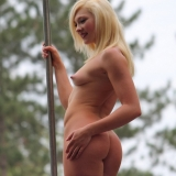 Hot girls getting naked at an outdoors public nudity festival
