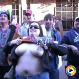 Watch as a chubby girl flashes her big juicy tits for beads at Mardi Gras