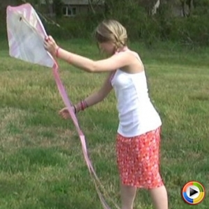 Watch as cute teen Shelby flies a kite at the park